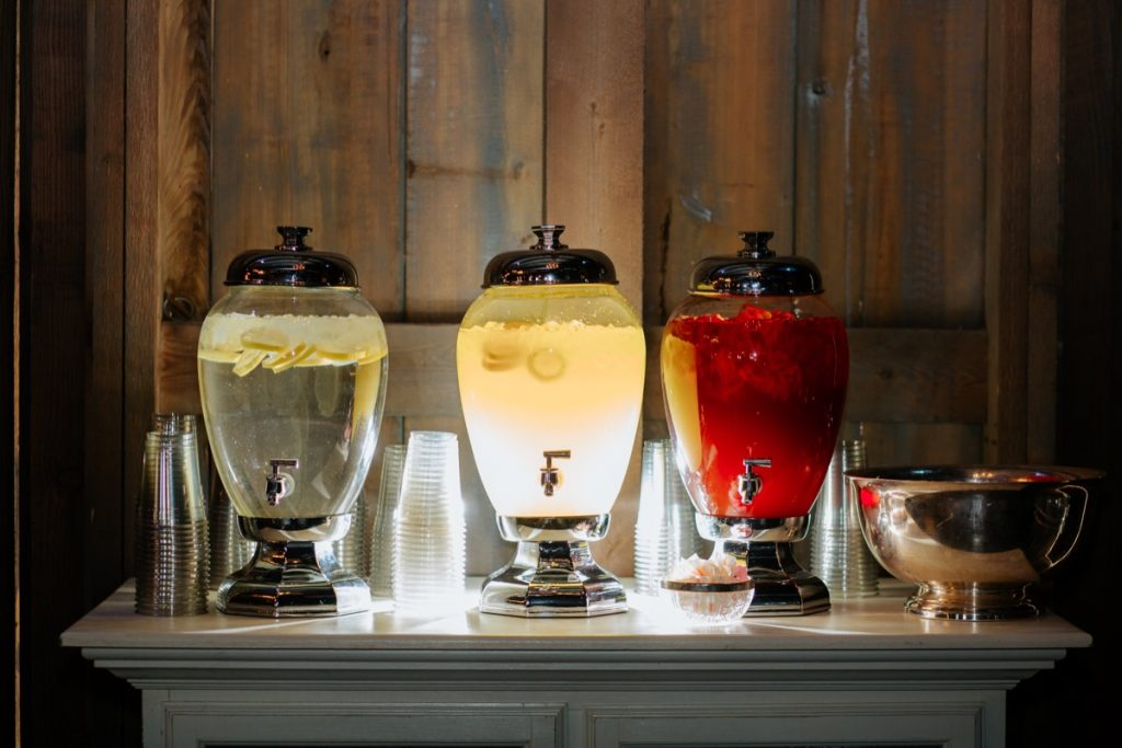 With great lighting comes great drama. This is only lemon infused water, lemonade, and punch... in glass dispensers.