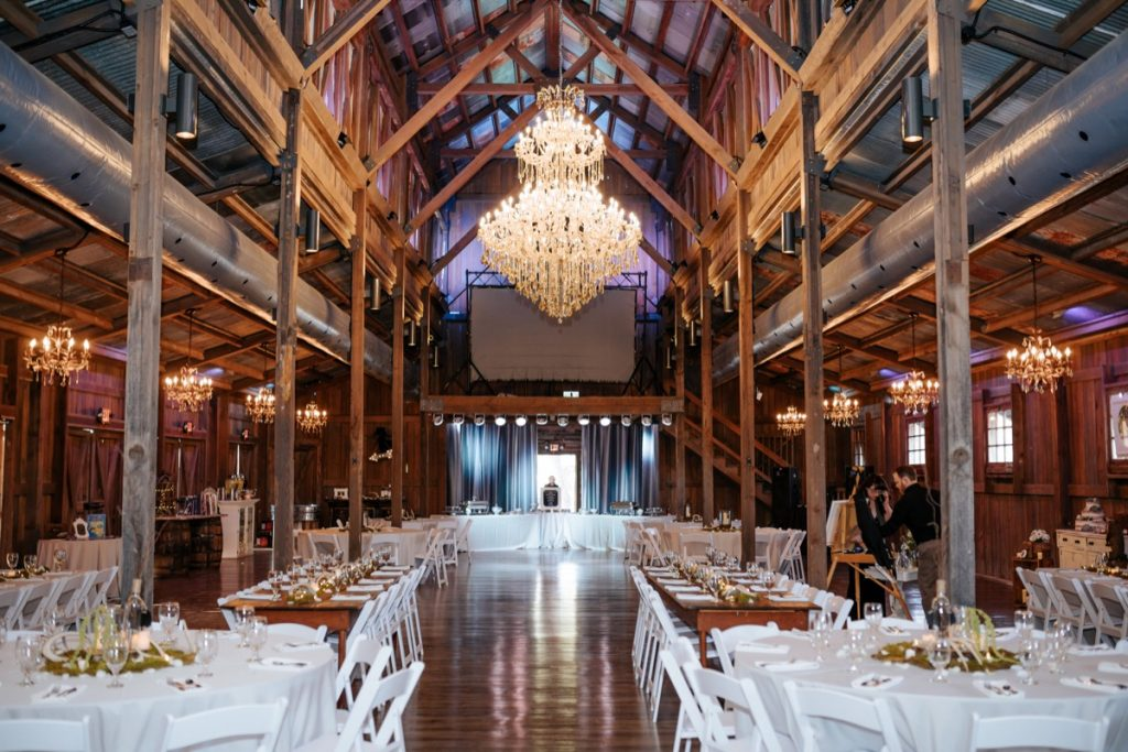 Interior of the Barn at Eagle Dance Ranch. showcasing the chandelier.