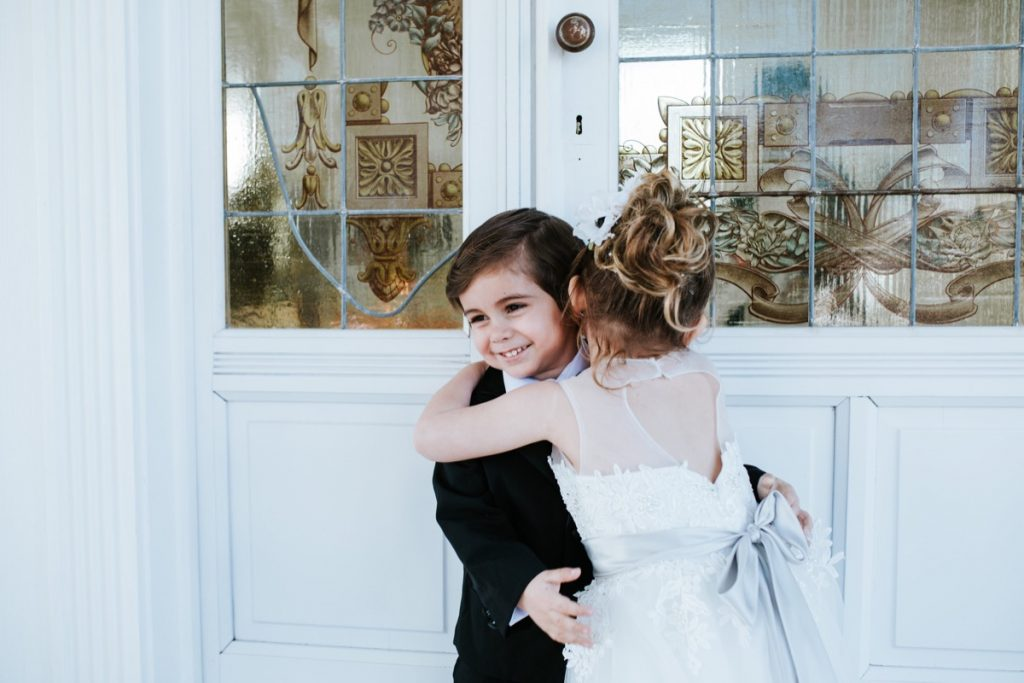 a boy and girl hug before the big day at Eagle Dance Ranch.