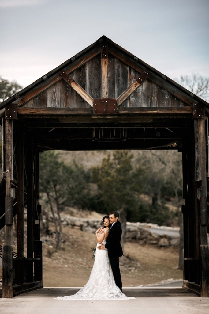 A couple standing right under the Creaky Covered Bridge in Eagle Dance Ranch. This bridge really is built to be creaky and sightly wobbly just because old covered bridges should be creaky and wobbly. It very safe, tho'