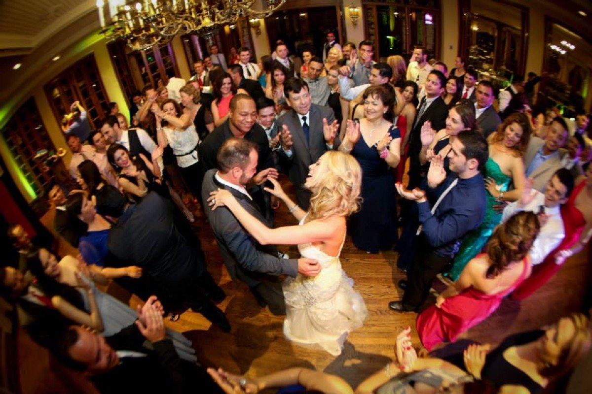 This bride (and groom) are in the center of the action with friends and family enjoyng their first dance as husband and wife at The Dominion.