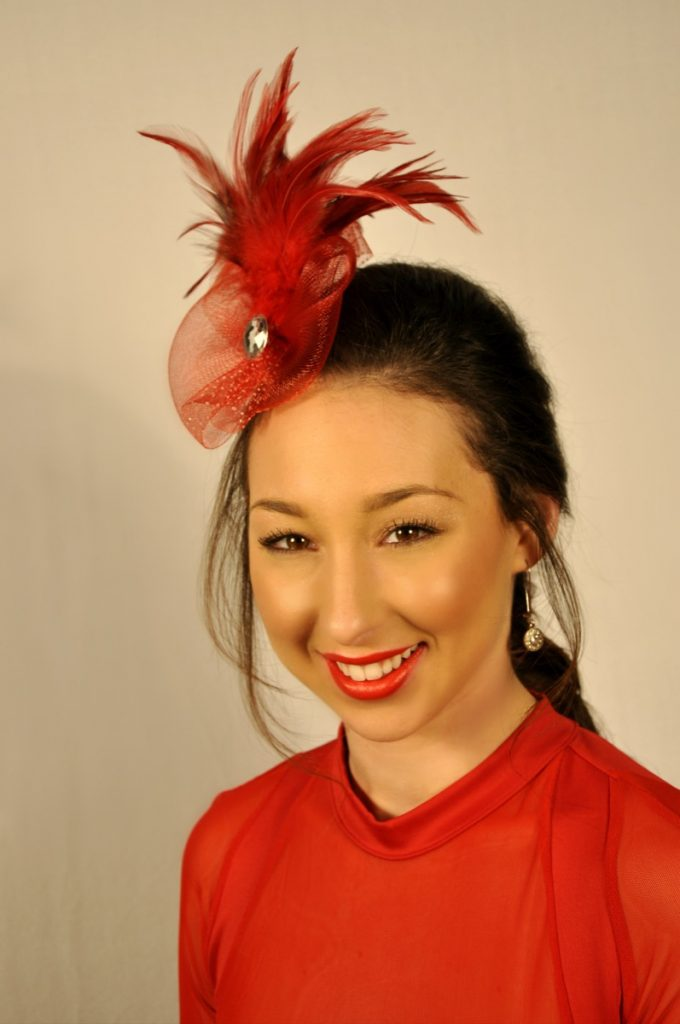 Indulgences Hair & Body Salon sez: There's something about a feathered fascinator that sets off a style