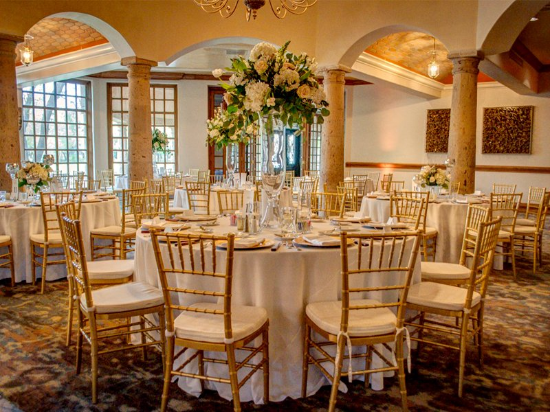 Golden chairs and white tablecloths make this ballroom at The Dominion look so exquisite!