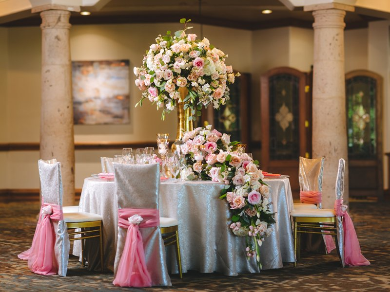 A table overflowing with flowers can be romantic from Events by A Touch of Elegance