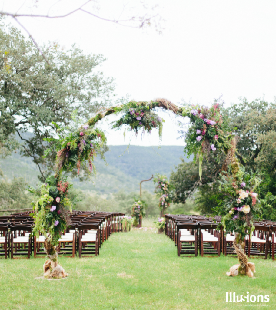 This archway to the ceremony site evokes a sense of old-world magic! Illusions Tents, Rentals, & Design