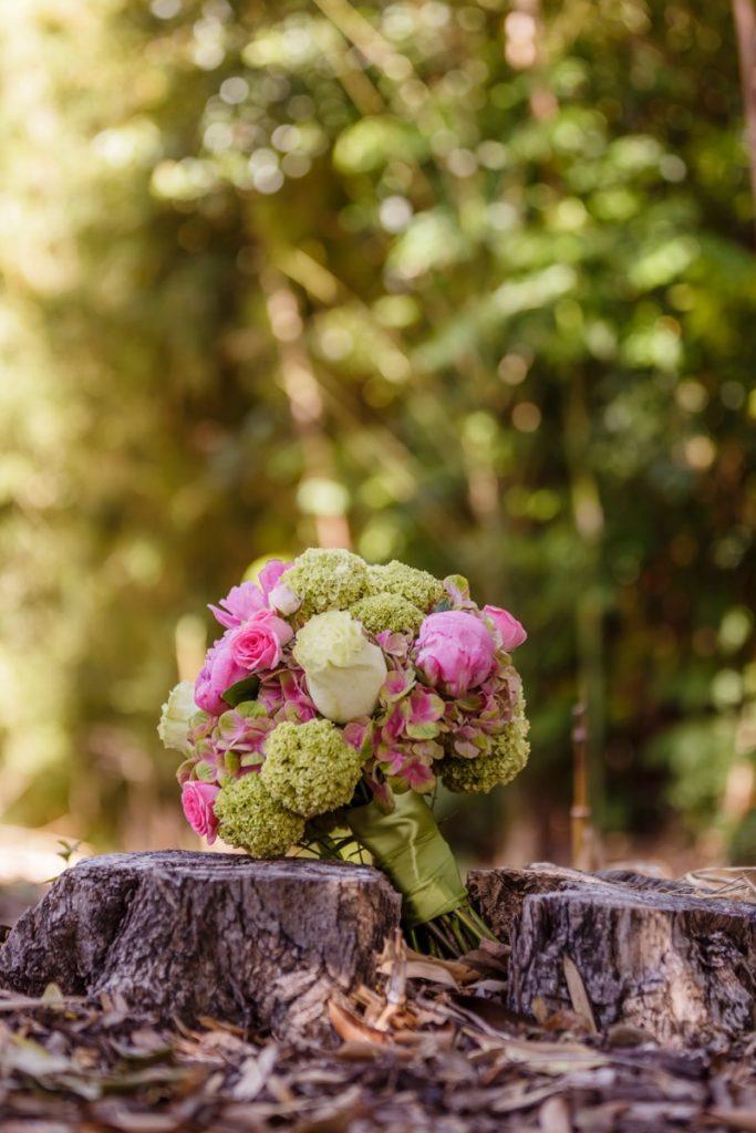 Alamo Plants & Petals shows the bride's bouquet on two tree stumps.