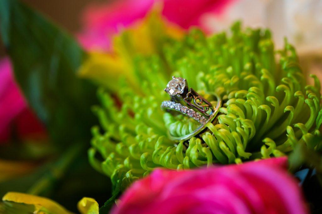 Alamo Plants & Petals displays the wedding rings inside a green flower stalks