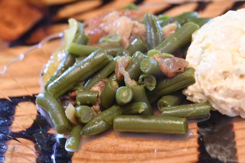 Blanco BBQ showcases some mighty fine green beans, as this close=up shot of a serving demonstrates.