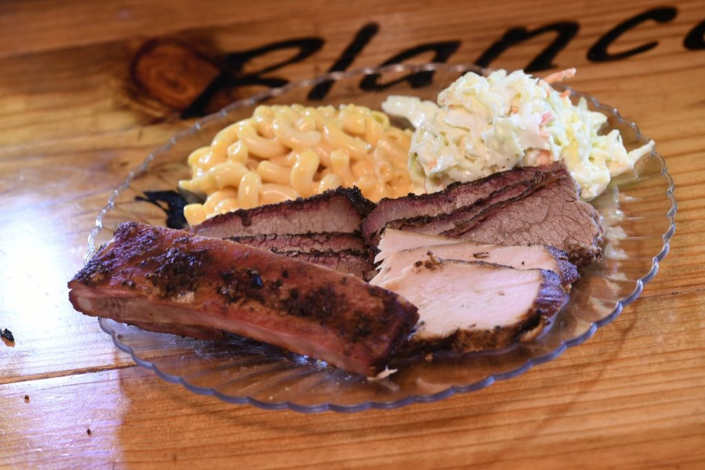 Blanco BBQ's standard fare of a beef rib, turkey, and brisket.... with a helping of cole slaw and macaroni-and-cheese.
