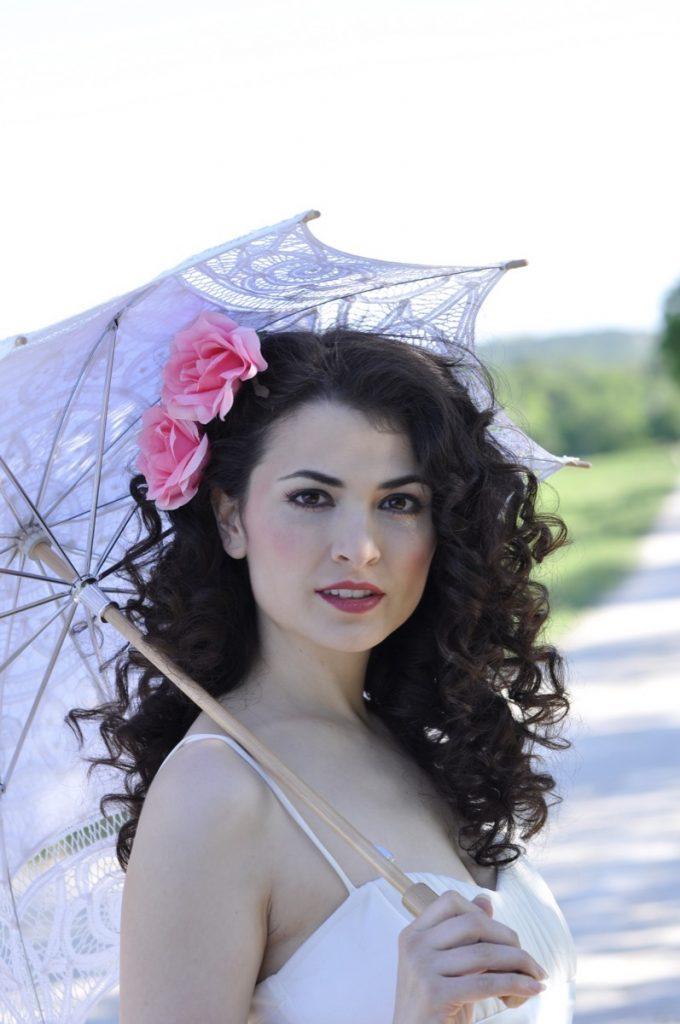 A close-up of the girl with the parasol by Indulgences Hair & Body Salon.
