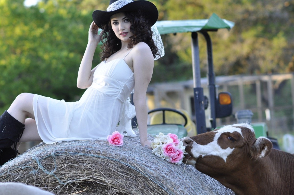 A country beauty on a haystack. Watch out for that cow! Indulgences Hair & Body Salon