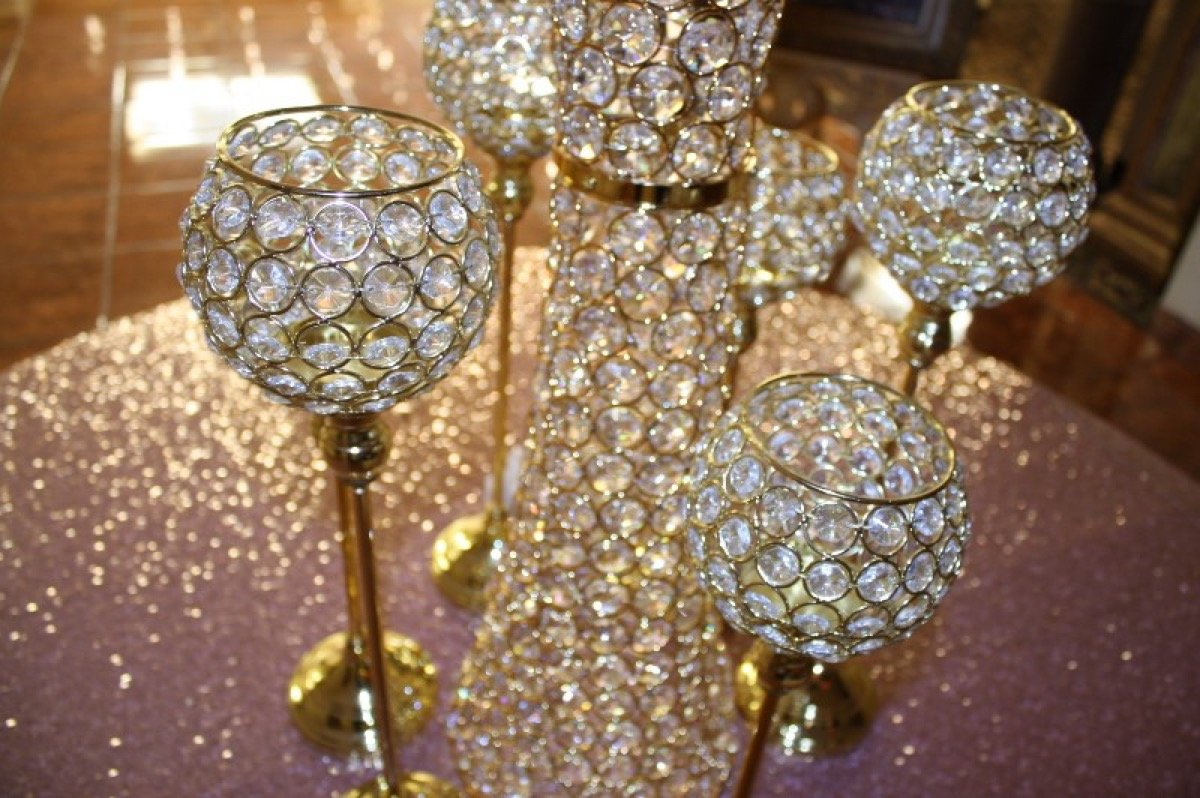 Close-up of golden goblets which are actually The Emporium by Yarlen candleholders!