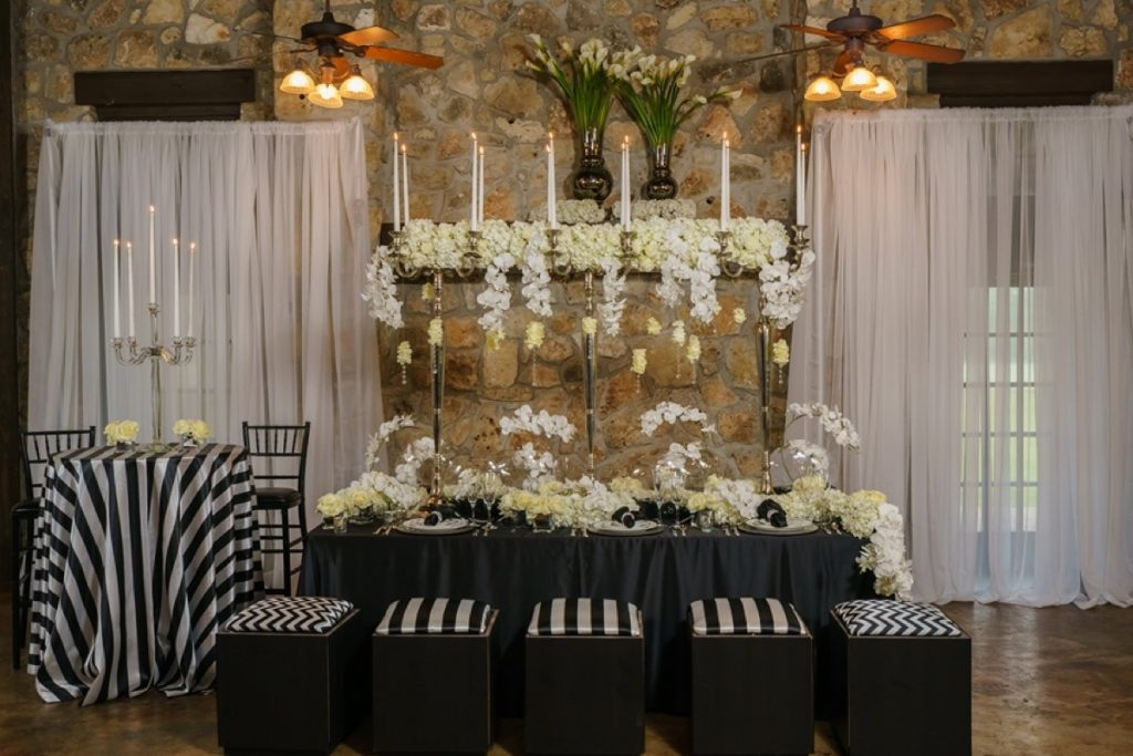 Illusions Tents, Rentals, & Design produces this razzle-dazzle wedding party table.