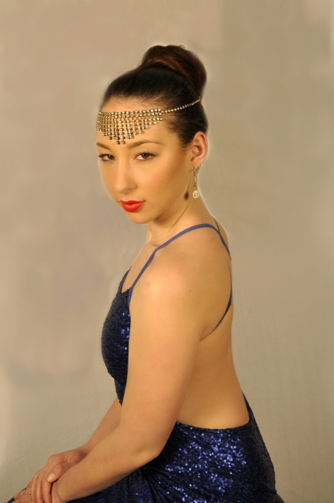 She became a seductress with this look by Indulgences Hair & Body Salon