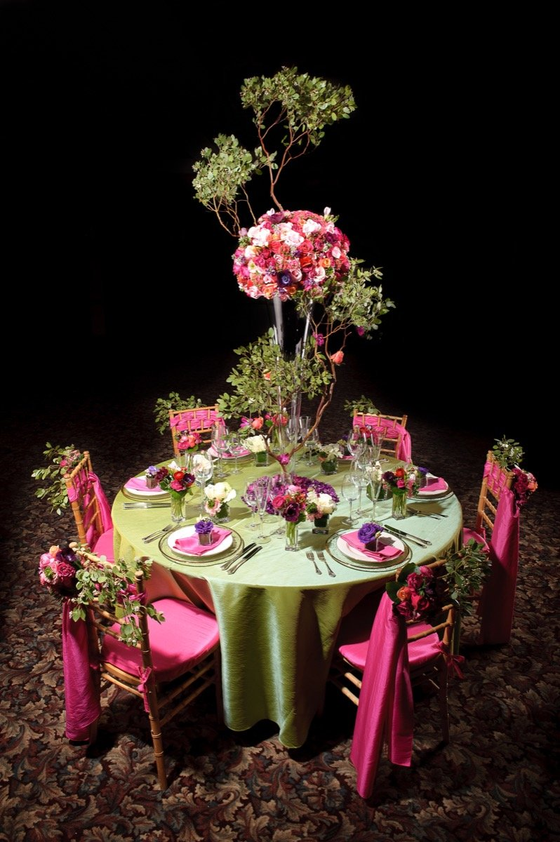 Illusions Tents, Rentals, & Design presents a very festive table with green and magenta!