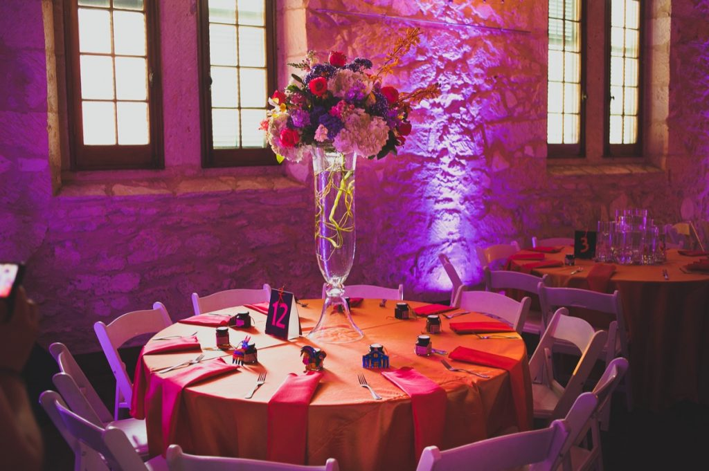 A fiery table bordered by purple lighting by Event Ignition.