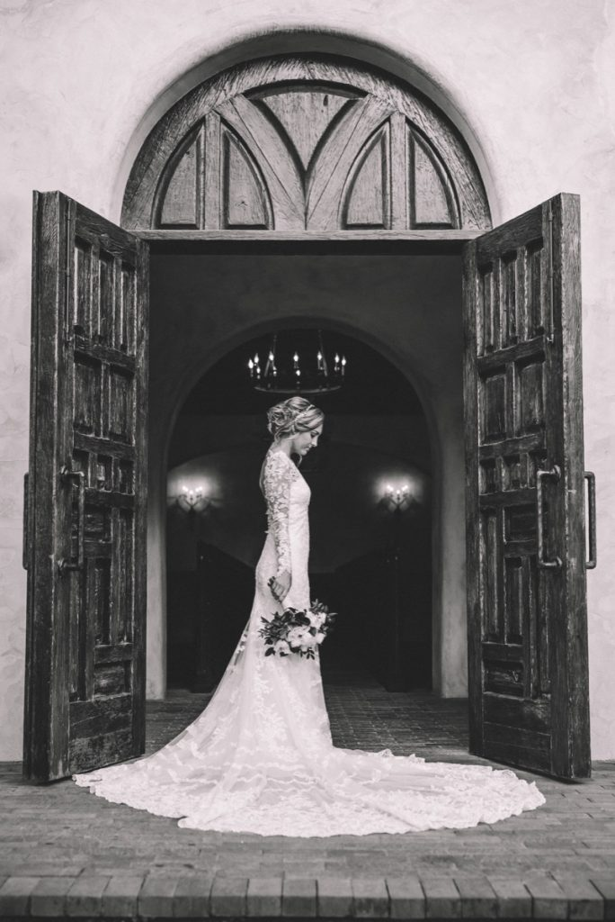 a model Bride stands forlornly in front of the Lost Mission doors.