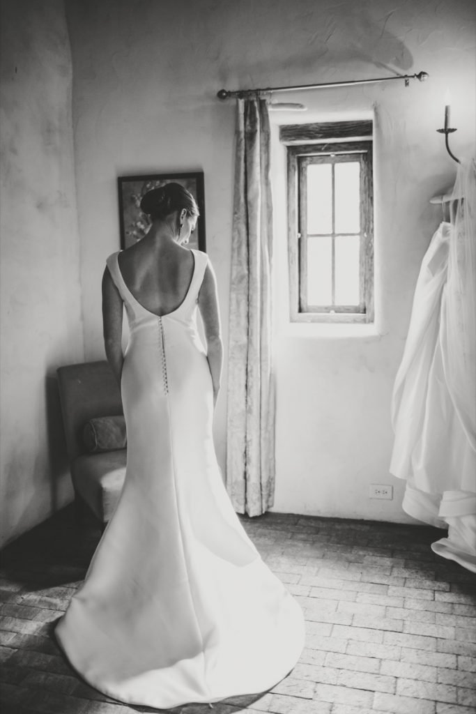 A bride stands before a Lost Mission window.