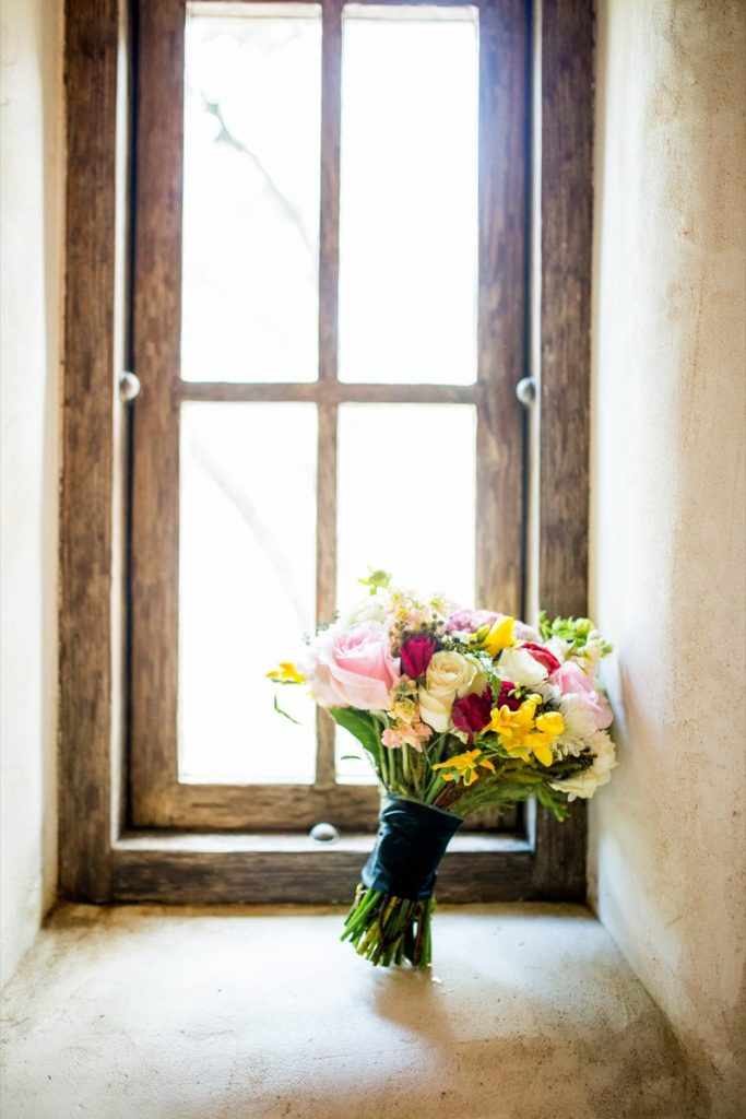 A lone Lost Mission bridal bouquet sits by a window.