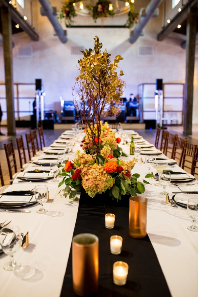 The yellow with peach colored florals centerpiece looks great! At Lost Mission.