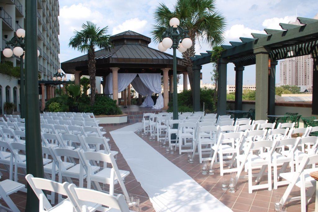 An exterior wedding ceremony set-up at the Hilton Palacio del Rio.