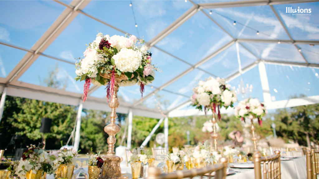 A casual upshot of a centerpiece by Illusions Tents, Rentals, & Designs.