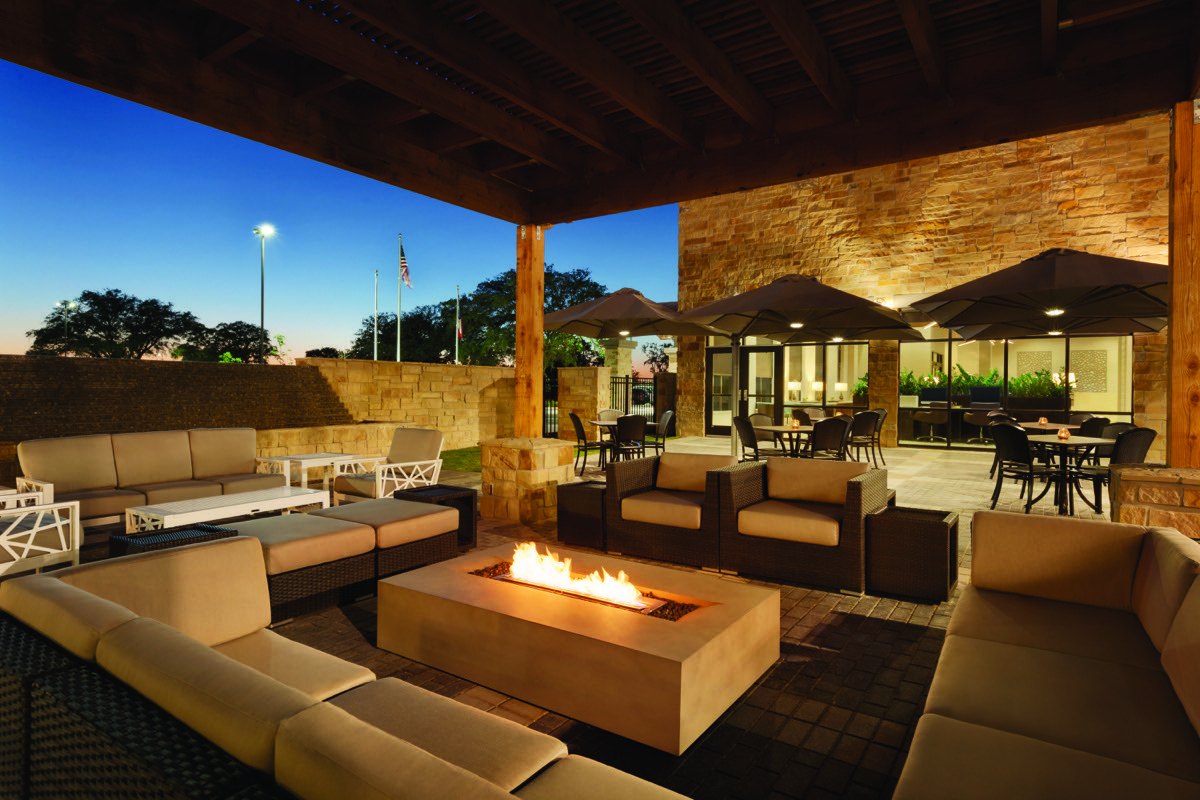 Classy and wonderful. Late dusk at the outdoor lounge area with a warm fire going and many chairs only at the Embassy Suites by Hilton Brooks Hotel.