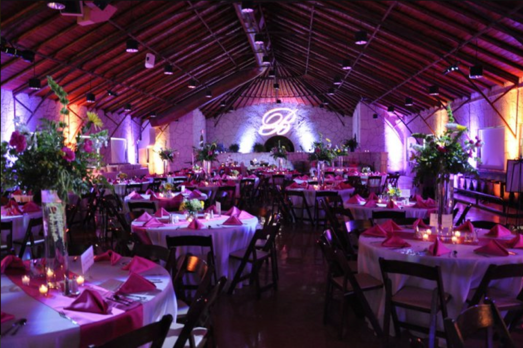 A pupleish hue surrounds the wedding banquet furnished by Event Ignition.