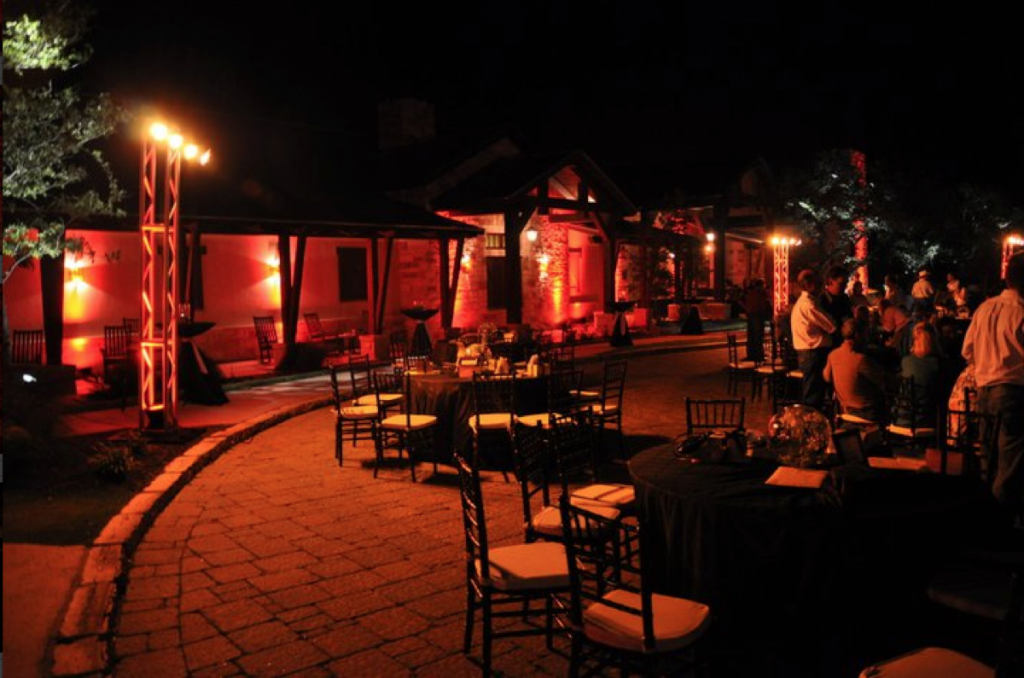 A susnset-like light surrounds party-goers with lighting furnished by Event Ignition