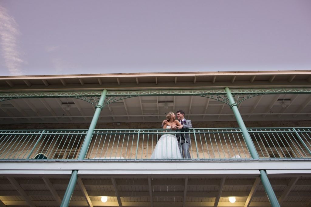 A wedded couple checks out downtown San Antonio from the balcony of the Pavilion, another part of the Hilton Palacio del Rio.