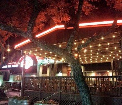 Blanco BBQ lit up at night.