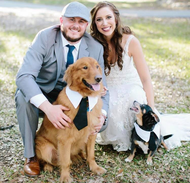 Canyon Lake Cabins & Cottages. A Happy couple with a well-dressed dog.
