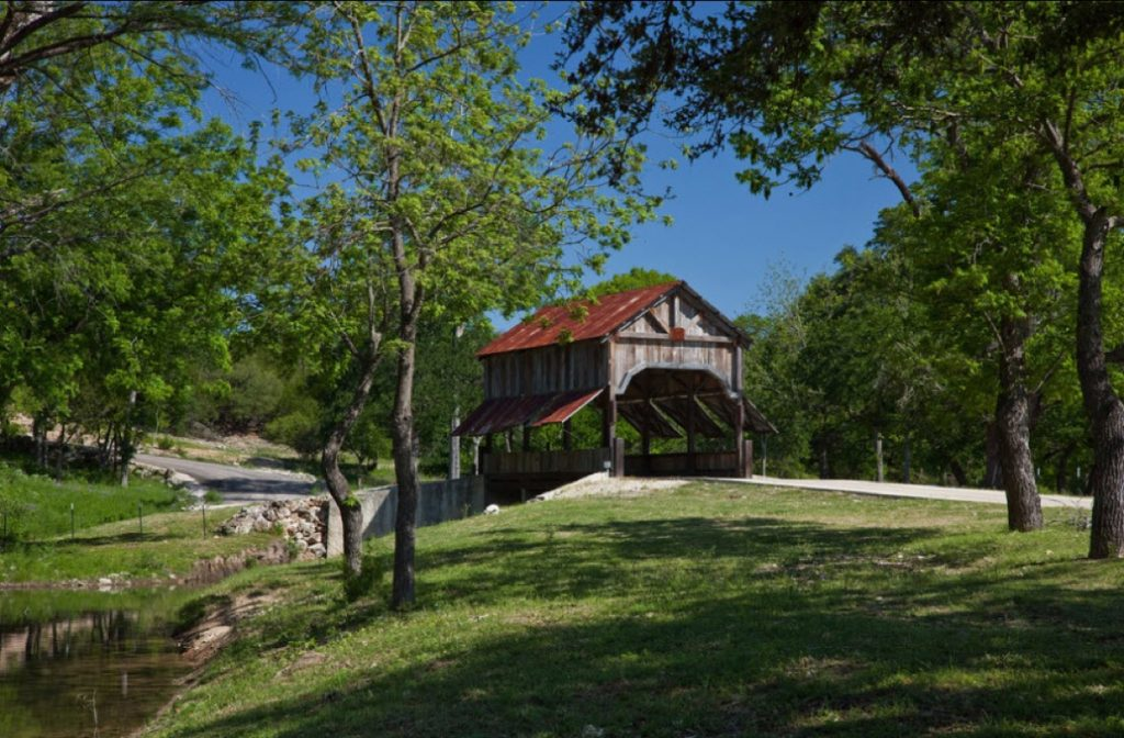Picturesque view of the Eagle Dance Ranch creaky covered bridge.