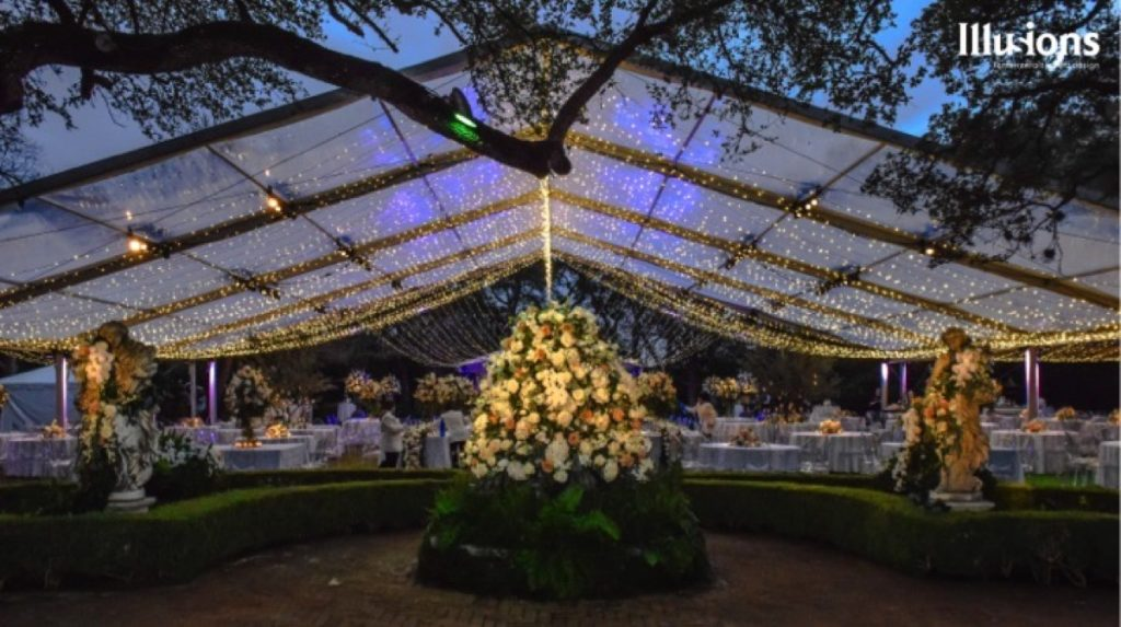 A magical tent by Illusions Tents, Rentals, & Design produces this wonderful feeling throughout the night.
