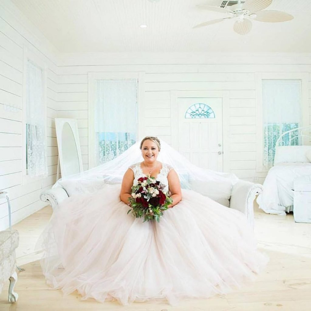A happy Bride in an almost all white room-Casa Blanca at Eagle Dance Ranch?