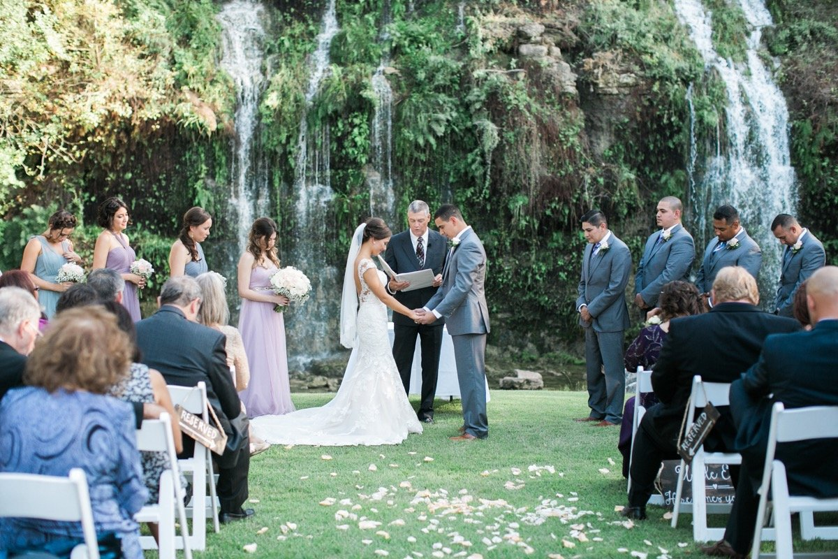 Yet another ceremony in front of a waterfall at Canyon Springs Golf Course. Magnificent.