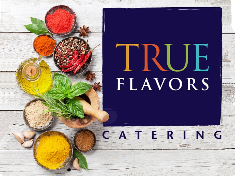 True Flavors logo on a board with spices