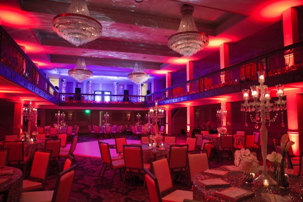 The St. Anthony Hotel Anachacho Room all litup in red hues