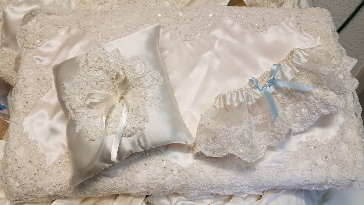 Using mom's old wedding gown to make a ring bearer pillow.