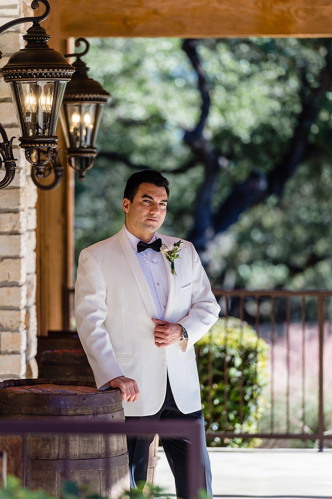 groom in white tux jacket in San Antonio wedding