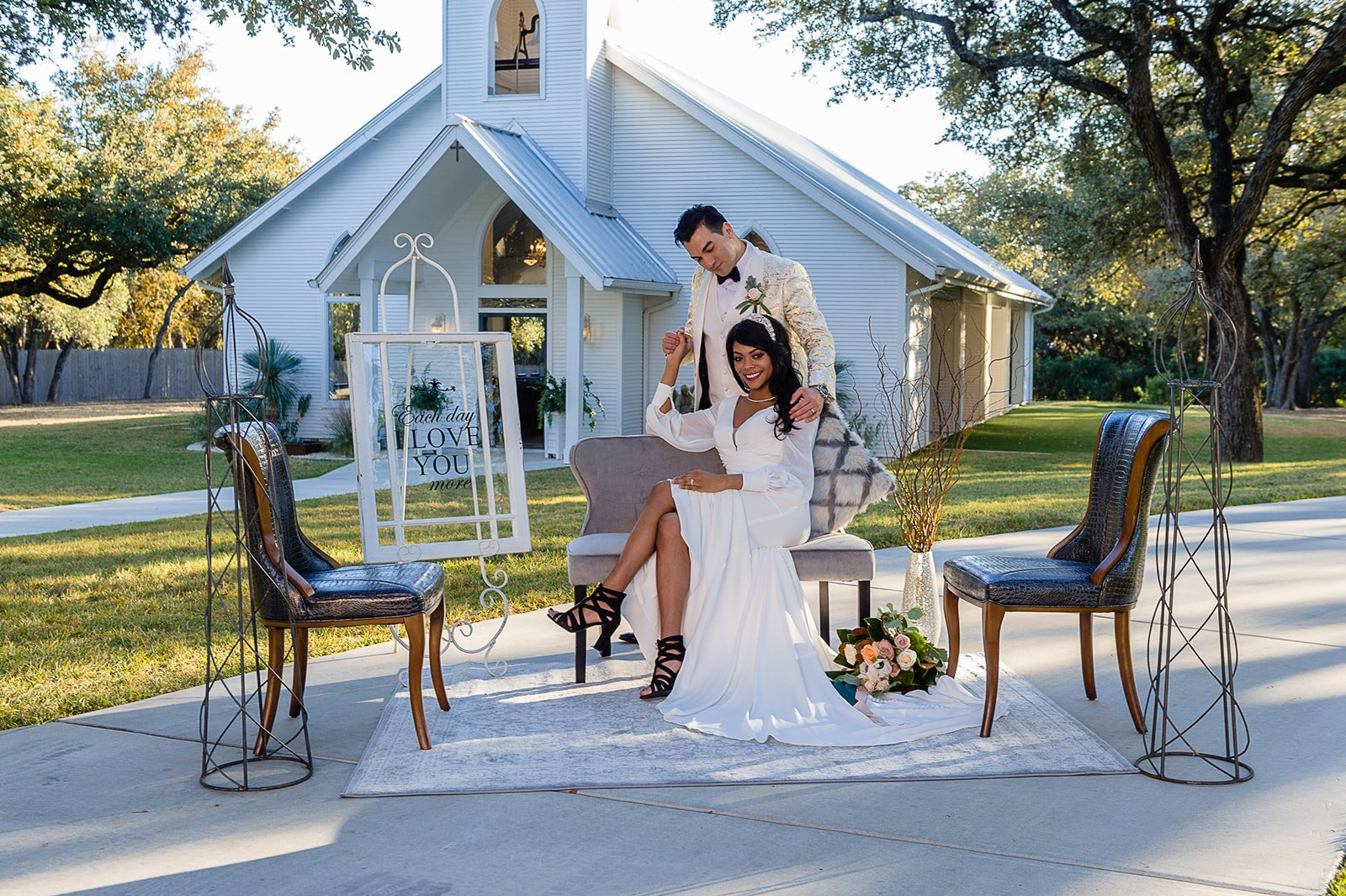 posed wedding photo at chandelier of gruene