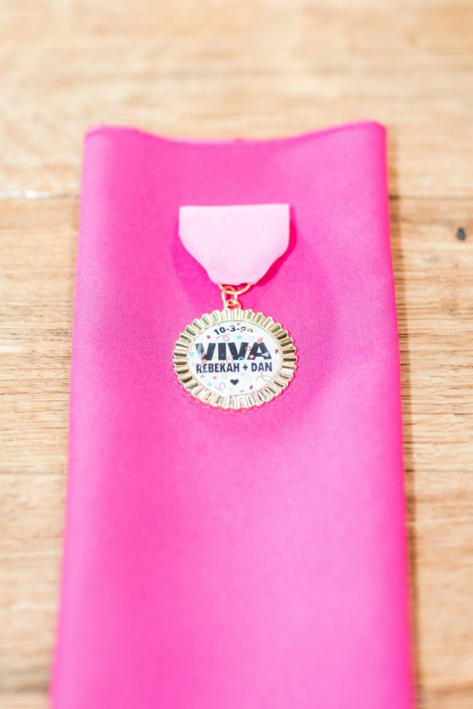 pink napkin with custome viva fiesta medals