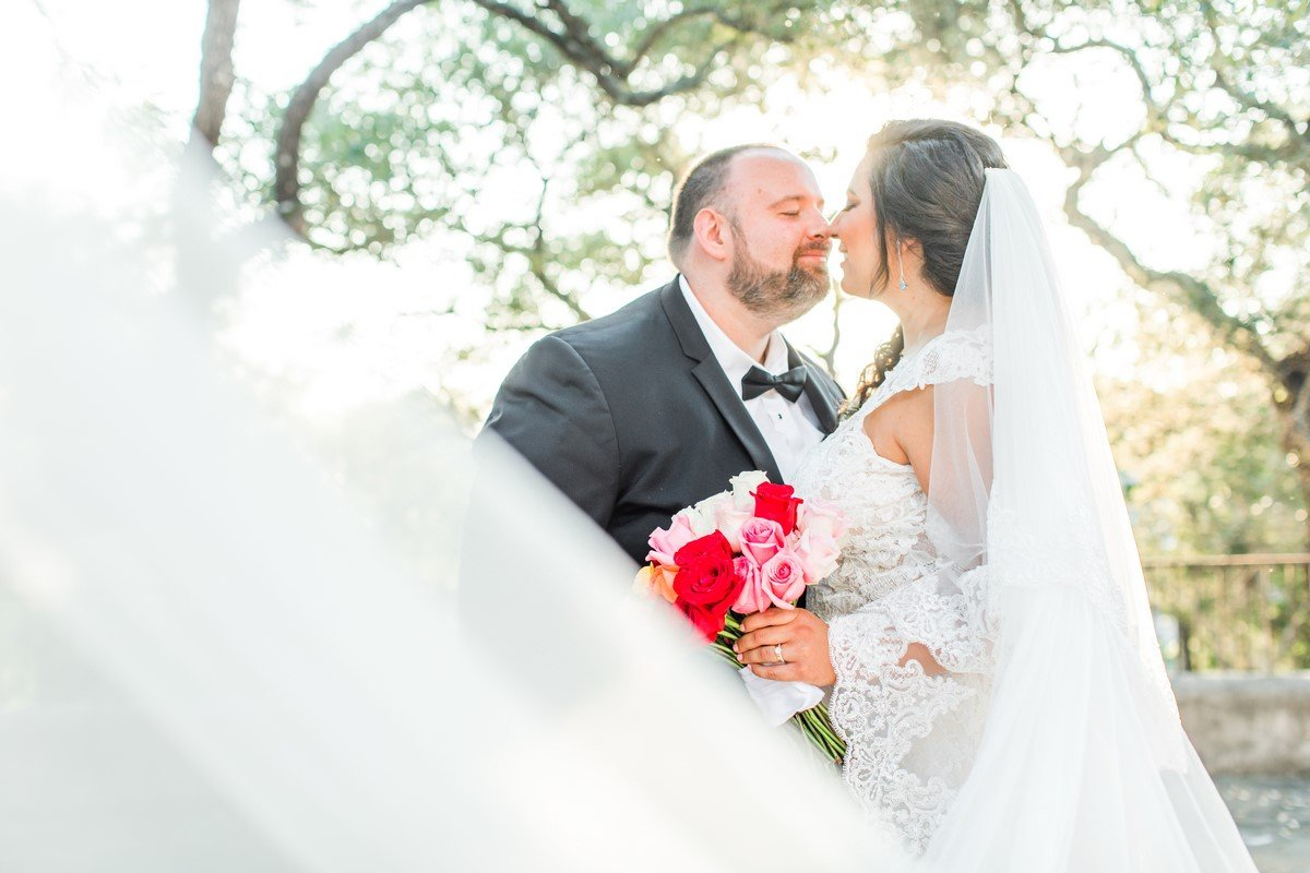 dreamy wedding newly wed natural lighting bridal veil shot