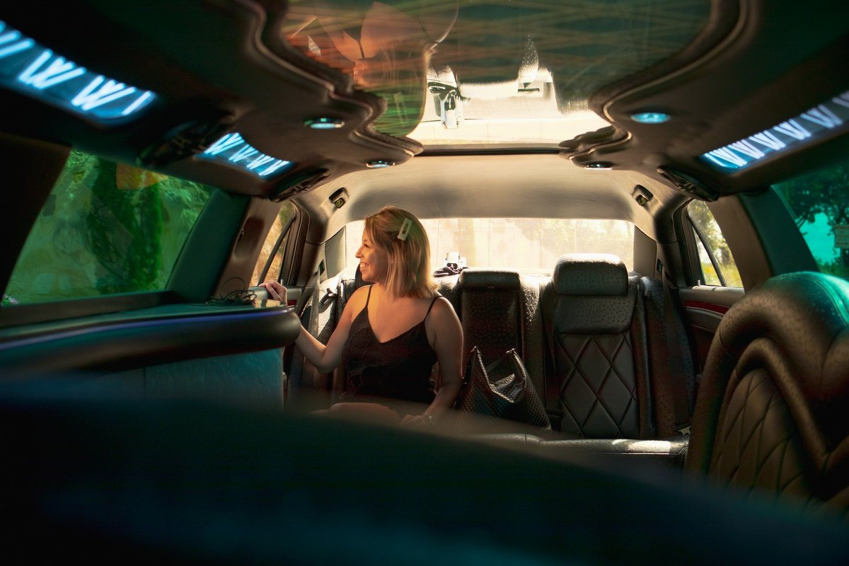girl. in limo anticipating a surprise