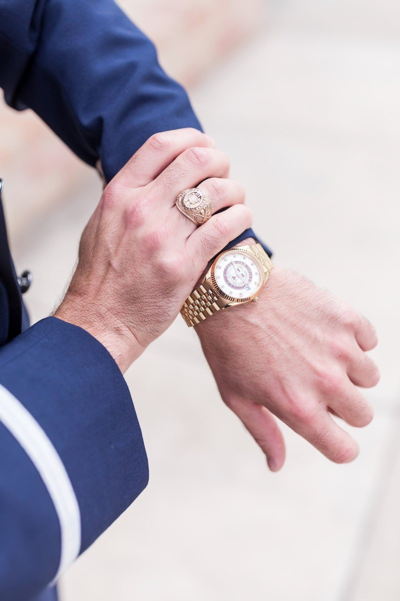 San Antonio groom showing his watch and aggie class ring