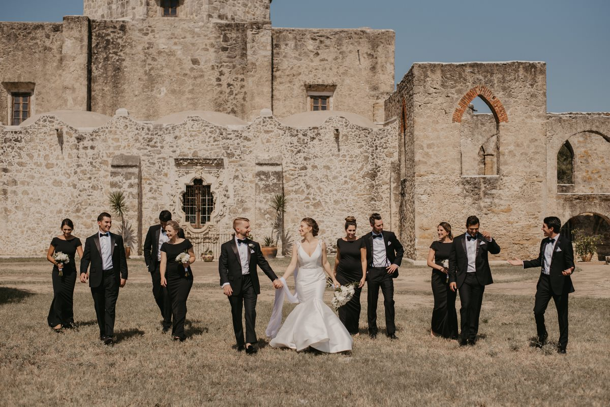 mission san Jose bridal party walking through field