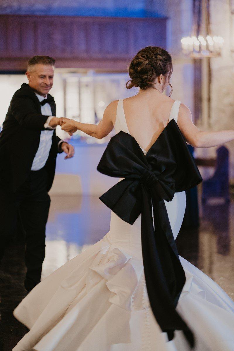 big black bow on the back of wedding dress in San Antonio weddings