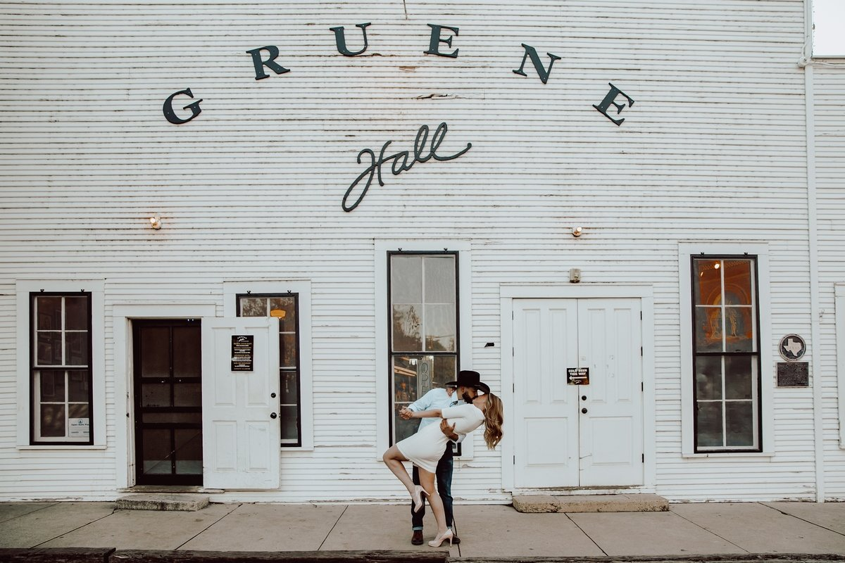 engagement kissing gruene white wood walls
