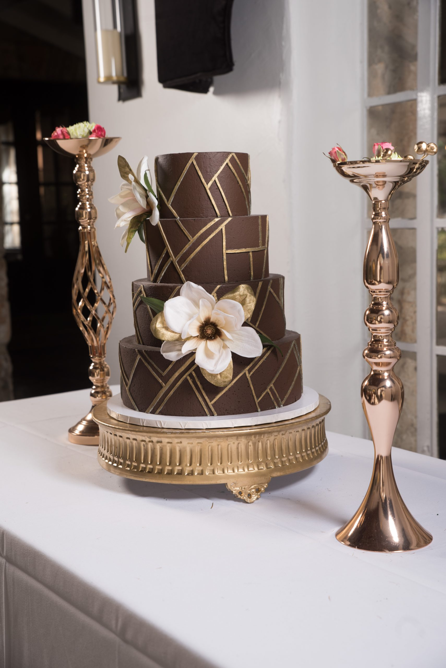 brown and gold wedding cake at Tuscany venue