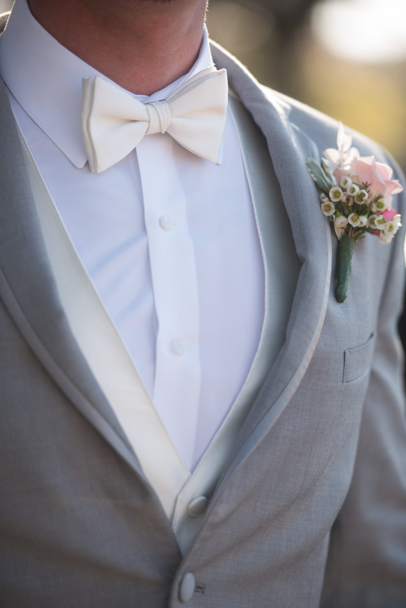 close up on grooms attire from rex formal wear at Tuscany venue